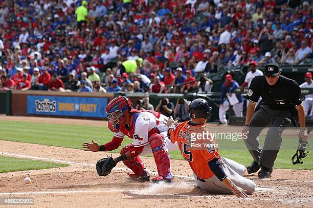 Cory Blaser umpire looks on as Jason Castro of the Houston Astros scores in the fifth inning against Robinson Chirinos of the Texas Rangers on...
