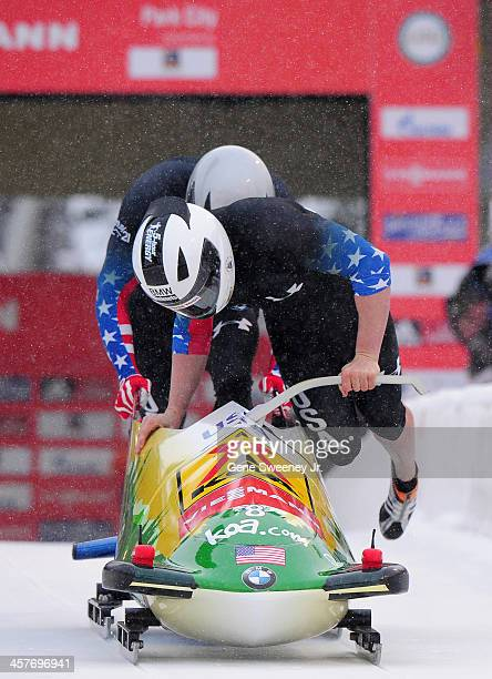 Cory Butner and Charles Berkeley of the United States start their run in the 2 man Bobsled competition during the Viessmann IBSF Bobsled and Skeleton...