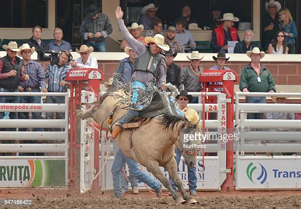 Cory Byrd from Douglas WY on Which Rocket during Novice Saddle Bronc competition at the Calgary Stampede 2016 Twenty of the world's top competitors...