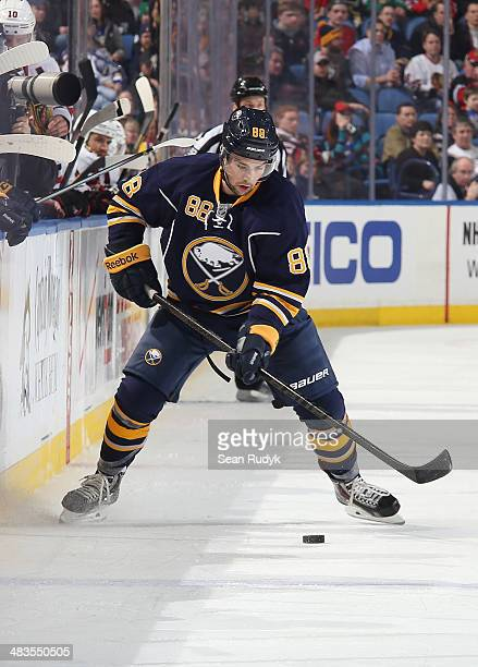Cory Conacher of the Buffalo Sabres skates with the puck against the of the Chicago Blackhawks at First Niagara Center on March 9 2014 in Buffalo New...