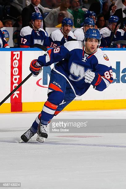 Cory Conacher of the New York Islanders skates against the Dallas Stars at Nassau Veterans Memorial Coliseum on October 25 2014 in Uniondale New York...