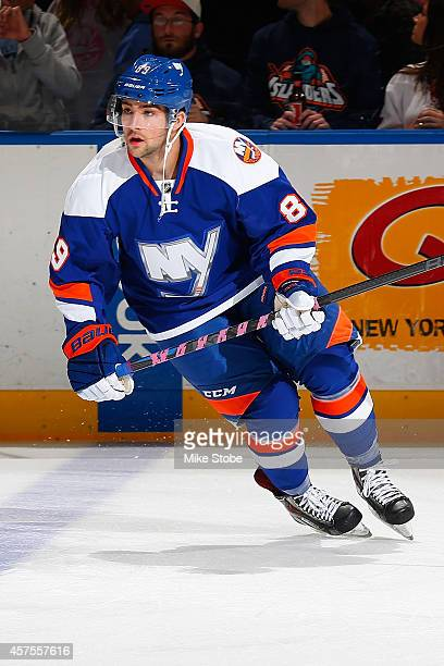 Cory Conacher of the New York Islanders skates during warmups prior to their game against the San Jose Sharks at Nassau Veterans Memorial Coliseum on...