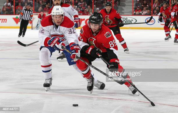 Cory Conacher of the Ottawa Senators skates the puck wide on Travis Moen of the Montreal Canadiens at Canadian Tire Centre on January 16 2014 in...