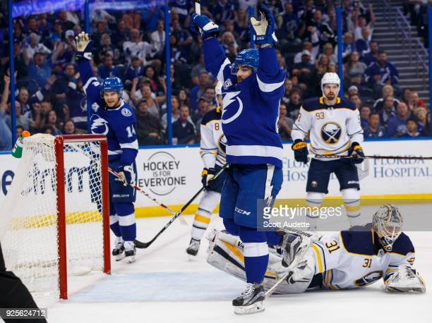 Cory Conacher of the Tampa Bay Lightning celebrates his goal against goalie Chad Johnson of the Buffalo Sabres during the first period at Amalie...