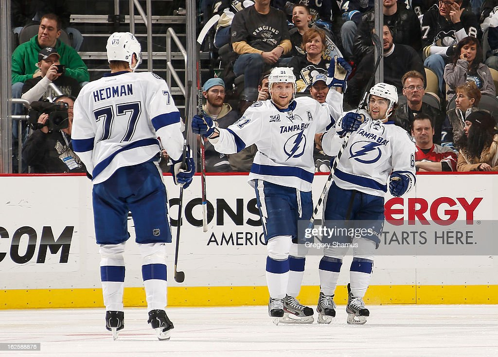 Cory Conacher #89 of the Tampa Bay Lightning celebrates his goal with Steven Stamkos #91 and Victor Hedman #77 during the game against the Pittsburgh Penguins on February 24, 2013 at Consol Energy Center in Pittsburgh, Pennsylvania.