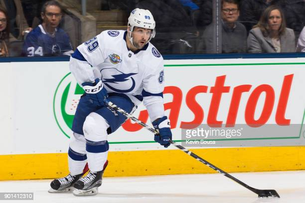 Cory Conacher of the Tampa Bay Lightning moves the puck against the Toronto Maple Leafs during the third period at the Air Canada Centre on January 2...