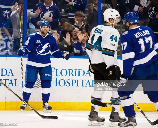 Cory Conacher of the Tampa Bay Lightning scores against the San Jose Sharks during the third period at Amalie Arena on December 2 2017 in Tampa...