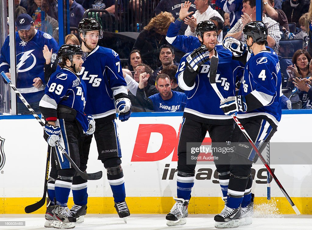 Cory Conacher #89, Victor Hedman #77, Ryan Malone #12 and Vincent Lecavalier #4 of the Tampa Bay Lightning celebrate after scoring during the third period of the game against the Winnipeg Jets at the Tampa Bay Times Forum on February 1, 2013 in Tampa, Florida.