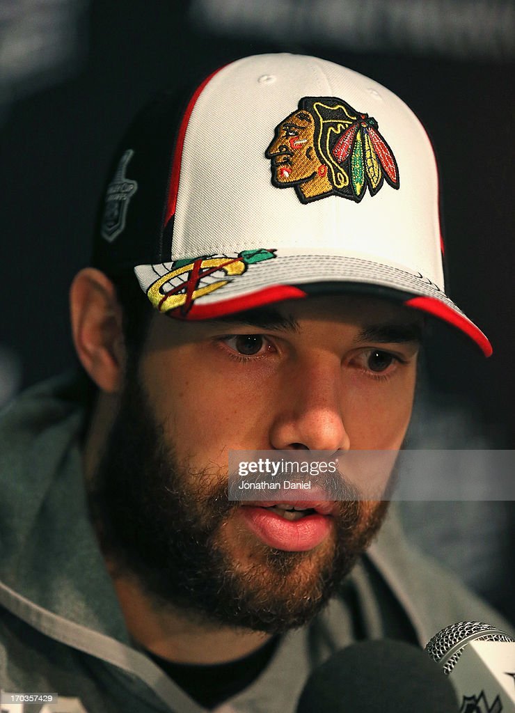 Cory Crawford #50 of the Chicago Blackhawks answers questions during the 2013 NHL Stanley Cup media day at the United Center on June 11, 2013 in Chicago, Illinois.