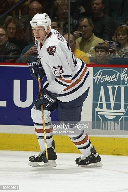 Cory Cross of the Edmonton Oilers skates during the game against the Calgary Flames at The Pengrowth Saddledome on December 23 2003 in Calgary...