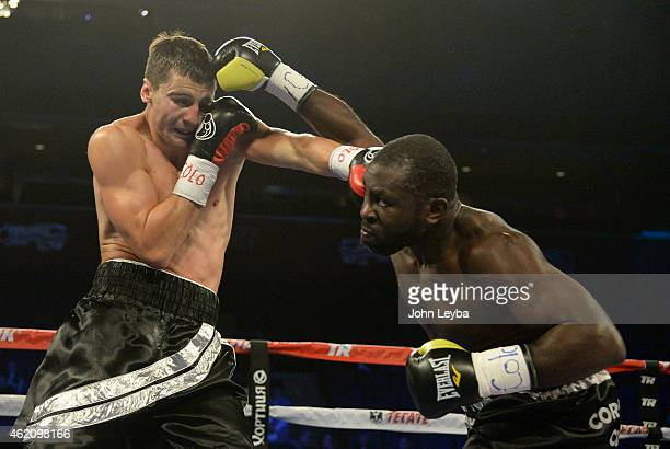 Cory Cummings and Oleksandr Gvozdyk both land a punch during the second round of their Super Welterweight fight January 24 2015 at 1st Bank Arena