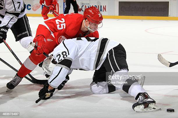 Cory Emmerton of the Detroit Red Wings and Jarret Stoll of the Los Angeles Kings tie up after a faceoff during an NHL game on January 18 2014 at Joe...