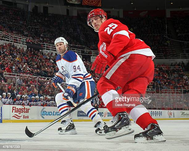 Cory Emmerton of the Detroit Red Wings follows the play next to Ryan Smyth of the Edmonton Oilers during an NHL game on March 14 2014 at Joe Louis...