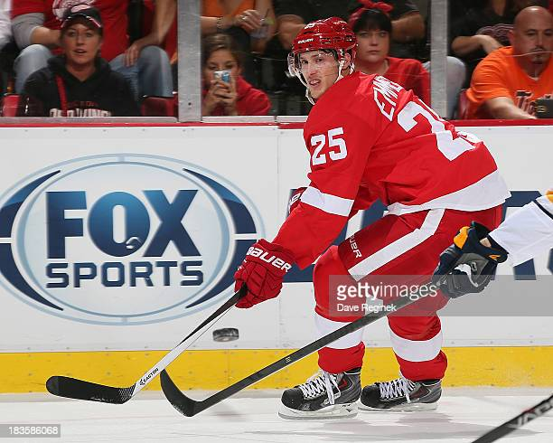 Cory Emmerton of the Detroit Red Wings makes a backhand pass during a NHL game against the Buffalo Sabres at Joe Louis Arena on October 2 2013 in...
