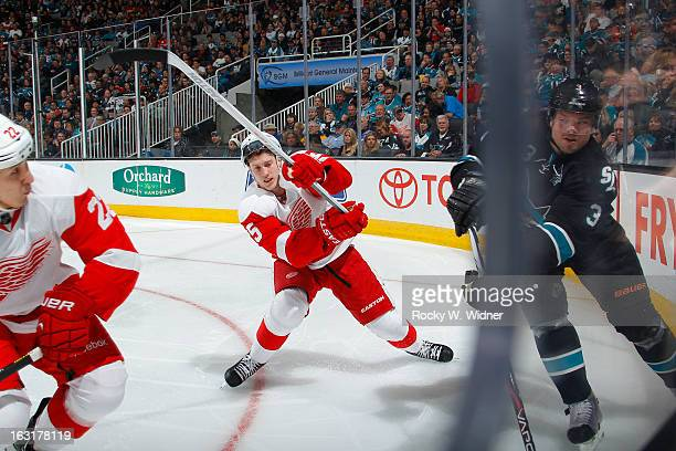 Cory Emmerton of the Detroit Red Wings skates after the puck against Douglas Murray of the San Jose Sharks at the HP Pavilion on February 26 2013 in...