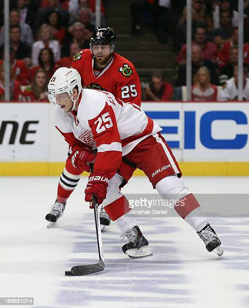 Cory Emmerton of the Detroit Red Wings skates past Viktor Stalberg of the Chicago Blackhawks in Game Seven of the Western Conference Semifinals...
