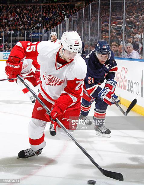 Cory Emmerton of the Detroit Red Wings skates with the puck against the New York Rangers at Madison Square Garden on January 16 2014 in New York City...