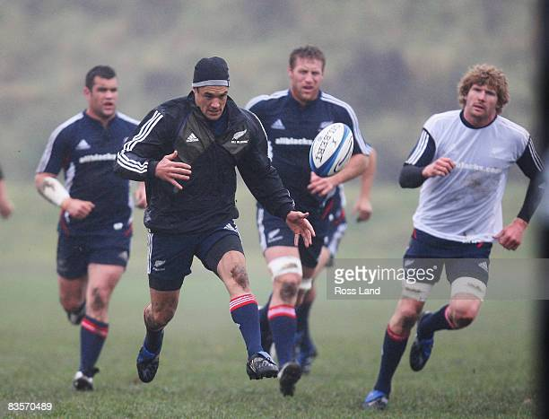 Cory Flynn, Dan Carter, Brad Thorn and Adam Thomson in action during a New Zealand All Blacks training session held at Perffermill fields November...