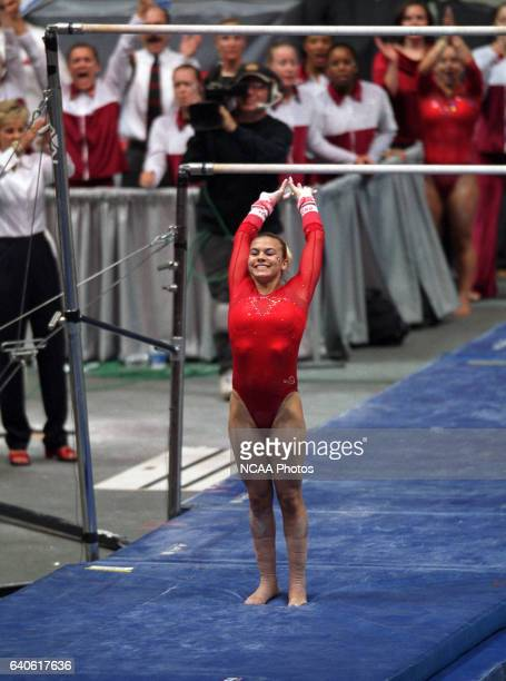 Cory Fritzinger of the University of Georgia competes on the uneven bars during the Super Six Team Finals of the NCAA Women's Division I Gymnastics...