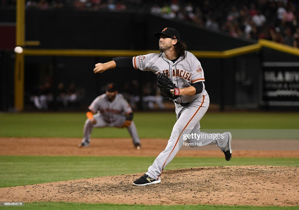 Cory Gearrin #26 of the San Francisco Giants delivers a ninth innning pitch against the Arizona Diamondbacks at Chase Field on June 30, 2018 in Phoenix, Arizona. Giants won 7-0.