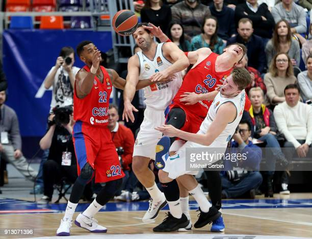 Cory Higgins #22 and Andrey Vorontsevich #20 of CSKA Moscow competes with Felipe Reyes #9 and Luka Doncic #7 of Real Madrid in action during the...