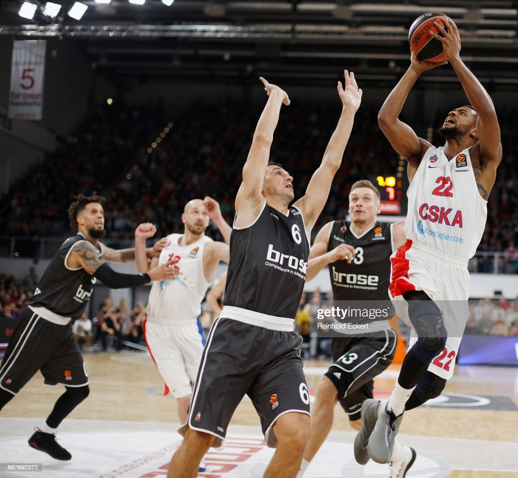 Cory Higgins, #22 of CSKA Moscow competes with Nikos Zisis, #6 of Brose Bamberg in action during the 2017/2018 Turkish Airlines EuroLeague Regular Season Round 11 game between Brose Bamberg and CSKA Moscow at Brose Arena on December 7, 2017 in Bamberg, Germany.