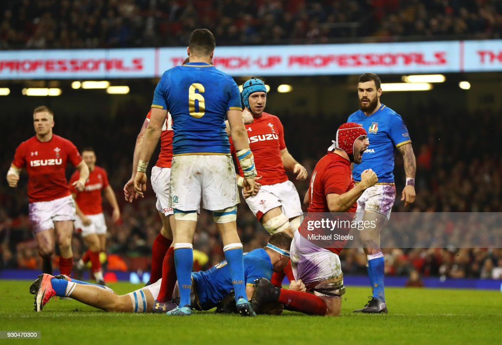 Cory Hill of Wales (red cap) celebrates as he scores their third try during the NatWest Six Nations match between Wales and Italy at Principality Stadium on March 11, 2018 in Cardiff, Wales.