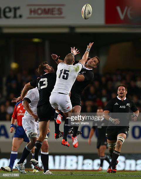 Cory Jane and Conrad Smith of the All Blacks compete for a high ball with Mike Brown of England during the International Test Match between the New...