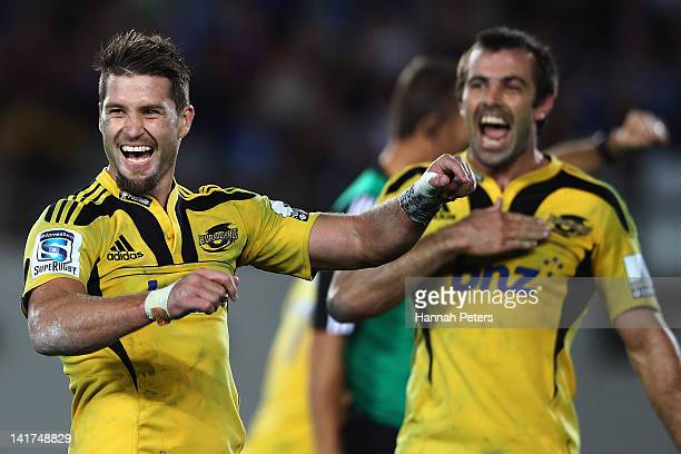 Cory Jane and Conrad Smith of the Hurricanes celebrate winning the round five Super Rugby match between the Blues and the Hurricanes at Eden Park on...