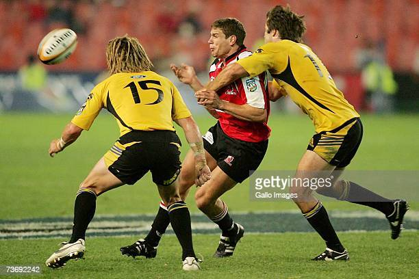 Cory Jane and Conrad Smith pf the Hurricanes tackle Jannie Boshoff of the Lions during the Super 14 match between the Lions and Hurricanes at Ellis...