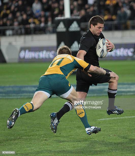 Cory Jane of New Zealand pushes off Drew Mitchell of Australia to score during the Tri-Nations rugby Test at the Westpac Stadium in Wellington on...