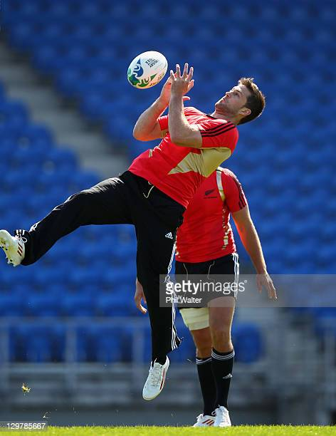 Cory Jane of the All Blacks catches the ball during a New Zealand All Blacks training session at Trusts Stadium on October 21 2011 in Auckland New...
