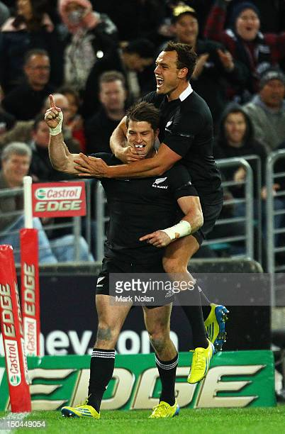 Cory Jane of the All Blacks celebrates his try during The Rugby Championship Bledisloe Cup match between Australia and New Zealand at ANZ Stadium on...
