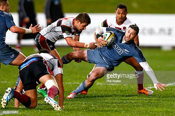 Cory Jane of the All Blacks is tackled against North Harbour during the New Zealand All Blacks Game of Three Halves at North Harbour Stadium on...