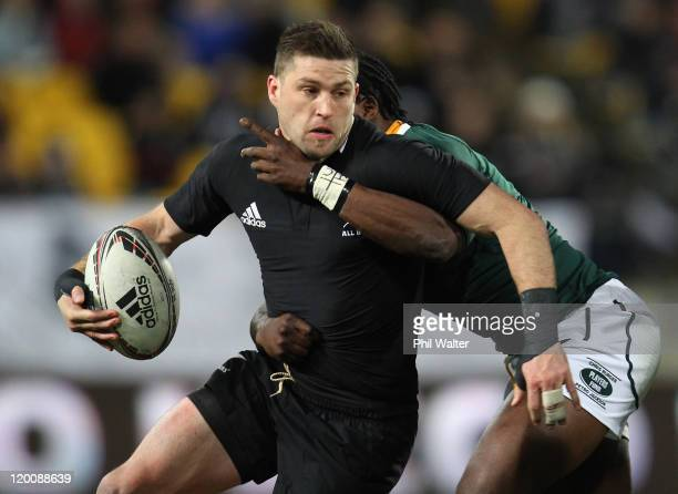 Cory Jane of the All Blacks is tackled by Lwazi Mvovo of South Africa during the TriNations match between the New Zealand All Blacks and the South...