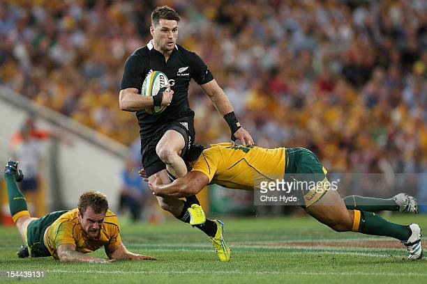 Cory Jane of the All Blacks is tackled during the Bledisloe Cup match between the Australian Wallabies and the New Zealand All Blacks at Suncorp...