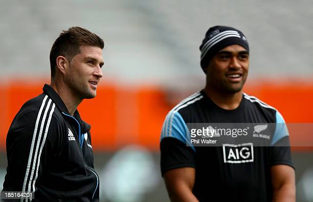 Cory Jane of the All Blacks looks on with Francis Saili during the New Zealand All Blacks captain's run at Forsyth Barr Stadium on October 18 2013 in...