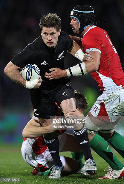 Cory Jane of the All Blacks makes a break during the First Test match between the New Zealand All Blacks and Wales at Carisbrook on June 19 2010 in...