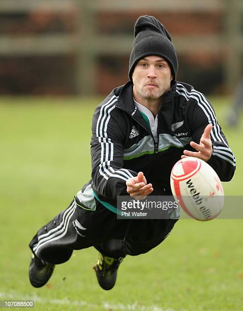 Cory Jane of the All Blacks passes the ball during a New Zealand All Blacks Training Session at the University of Bath on November 23 2010 in Bath...