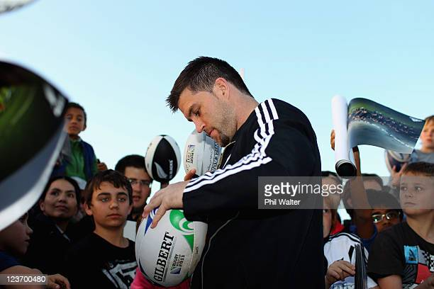 Cory Jane of the All Blacks signs autographs during a New Zealand All Blacks IRB Rugby World Cup 2011 fan day at the Pakuranga Rugby Club on...