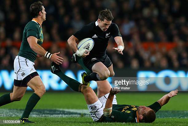 Cory Jane of the All Blacks tramples over Francois Steyn of South Africa during the Rugby Championship match between the New Zealand All Blacks and...