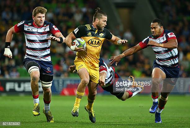 Cory Jane of the Hurricanes beats the Rebels defence to score a try during the round eight Super Rugby match between the Rebels and the Hurricanes at...