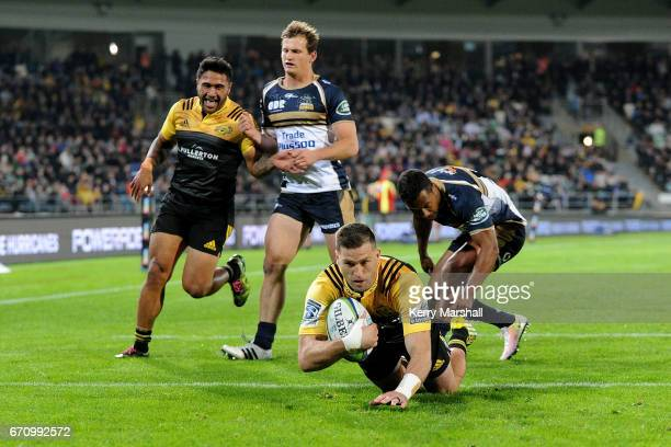 Cory Jane of the Hurricanes dives to score a try during the round nine Super Rugby match between the Hurricanes and the Brumbies at McLean Park on...