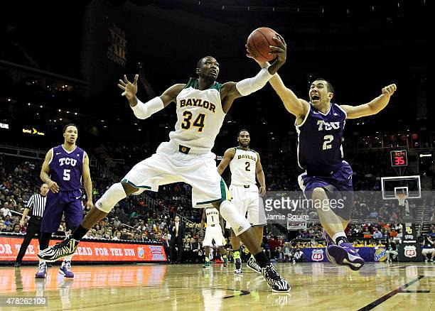 Cory Jefferson of the Baylor Bears and Michael Williams of the TCU Horned Frogs vie for a loose ball during the Big 12 Basketball Tournament first...