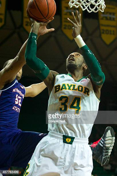 Cory Jefferson of the Baylor Bears drives to the basket against the Northwestern State Demons on December 18 2013 at the Ferrell Center in Waco Texas