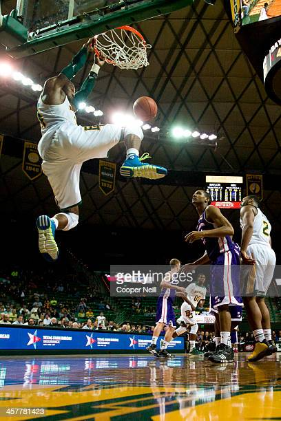 Cory Jefferson of the Baylor Bears dunks the ball against the Northwestern State Demons on December 18 2013 at the Ferrell Center in Waco Texas