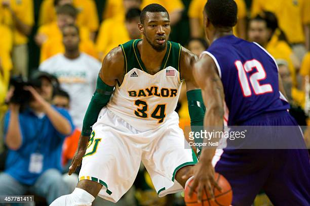 Cory Jefferson of the Baylor Bears plays defense against Jalan West of the Northwestern State Demons on December 18 2013 at the Ferrell Center in...