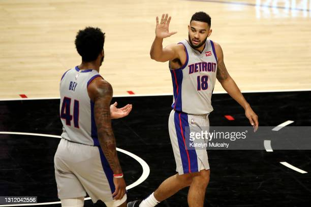 Cory Joseph and Saddiq Bey of the Detroit Pistons react to a play during the third quarter against the Los Angeles Clippers at Staples Center on...