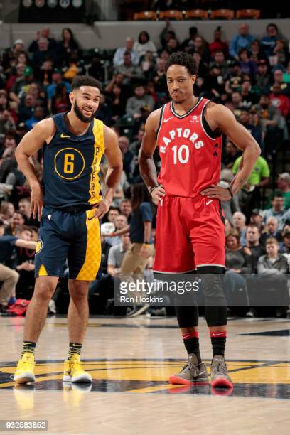 Cory Joseph of the Indiana Pacers and DeMar DeRozan of the Toronto Raptors during the game on March 15 2018 at Bankers Life Fieldhouse in...