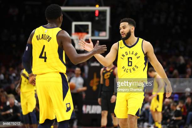 Cory Joseph of the Indiana Pacers celebrates during the fourth quarter with Victor Oladipo while playing the Cleveland Cavaliers in Game One of the...